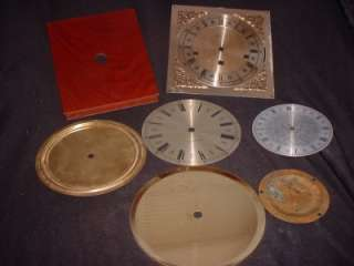 Featured are three clock dials, pans and one cherry colored clock