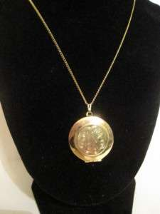 darling, gold tone necklace with locket pendant with geometric design