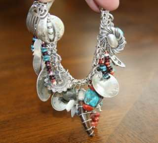 Bracelet. It has about 20 Sterling Silver charms plus many more bead