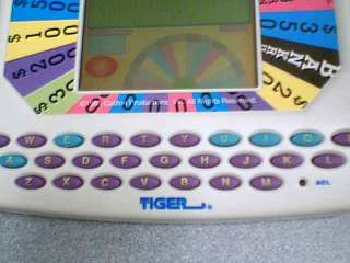 PRODUCTIONS, INC TIGER ELECTRONICS WHEEL OF FORTUNE LCD HAND HELD