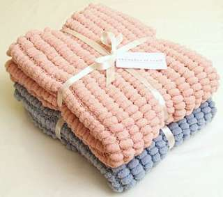 How to Knit a Scarf With Pom Pom Wool | eHow